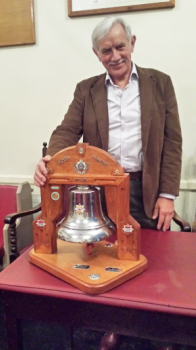 Ex-firefighter W.Bro. Bob Greenwell PrGSwdB with the bell